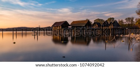 Colorfull sunset at Lake Dwellings of the Stone and Bronze Age in Unteruhldingen on Lake Constance, Baden-Wurttemberg. Germany