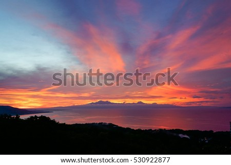 colorfull sunset behind mountains of tropical island Siqijor