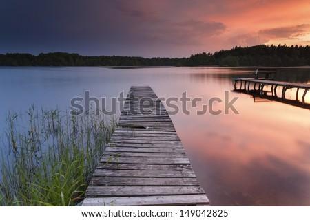 Colorfull sunset on Bobi?cino lake in north Poland. Pomerania district.