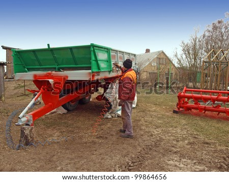 Coloring agricultural machine by sprayer after repairing