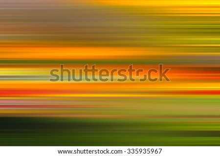 Colors background. green, red, orange, yellow. Blur abstract image. Blurring background. Blurred light. Variety of color. Background for motivational text. Motion blur. Autumn colors.