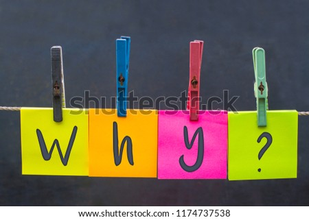 Colors Blank pieces of papers hang on clothesline on grey textures background; with inscription why concept