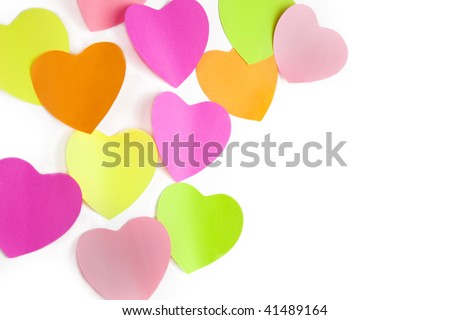 colors note papers hearts on white wall /  with copy space for your text - stock photo