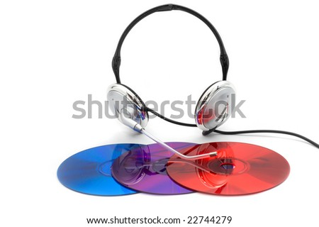 Colors of communication: red, blue and purple compact discs and headphones accessory isolated