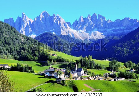 Colors of Dolomites. funes view of the valley, Puez-Odle in autumn. at sunset holy magdalena. View of odle mountain #516967237