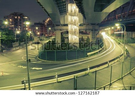 colors of night Tokyo with huge illuminated highway structure