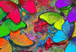 colors of rainbow. color concept. bright tropical morpho butterflies on an artist's palette. art paints and butterflies colorful background