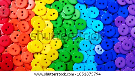 Colors of rainbow. Pattern of multicolored buttons  texture background. Palette of colors of a rainbow. #1051875794