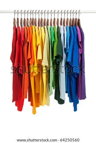 Colors of rainbow. Variety of casual shirts on wooden hangers, isolated on white.