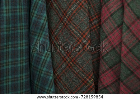 Colors of tartan seamless plaid pattern in fabric store. #728159854