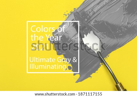 Colors of the year 2021 Ultimate Gray and Illuminating background. Ultimate gray paint oil color on yellow illuminating background.