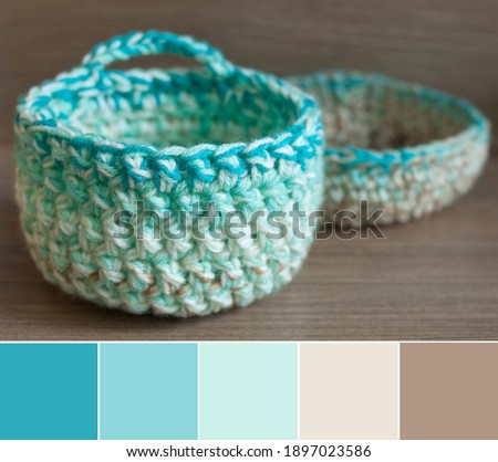 Colors of yarn basket bowls - green, turquoise, creamy beige and brown, shallow depth of focus. Color palette swatches, fresh trendy combination of colors for styling, pastel delicate ground nuances. Photo stock ©