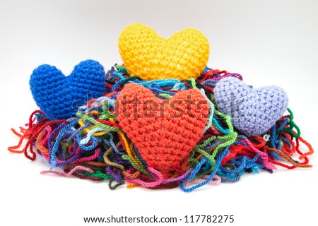 colors woolen hearts on white fund