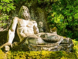 Colossal sculpture of god Neptune at famous Park of the Monsters, also named Sacred Grove, Bomarzo Gardens, province of Viterbo, Lazio, Italy