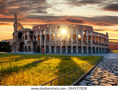 Shutterstock colosseum against colorful sunset in rome italy 244377838