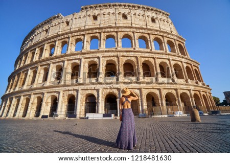 Colosseum and young tourist woman near gladiator arena famous ancient history roman empire architecture exterior theater historical travel tourism landmark ruin monument stadium building Italy Rome. #1218481630