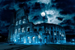 Colosseum at night, Rome, Italy. Mystery creepy view of Ancient Coliseum in full moon. Spooky dark scene with famous landmark in Rome city center in blue light. History, Halloween and horror concept.