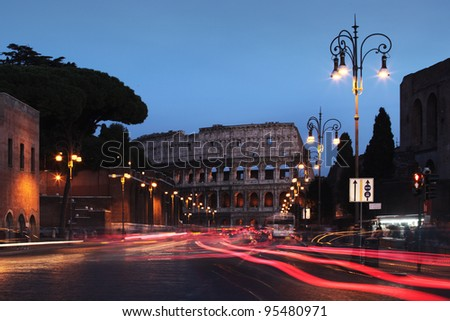 Colosseum at night with moving cars, long exsposure photography, Rome, Italy