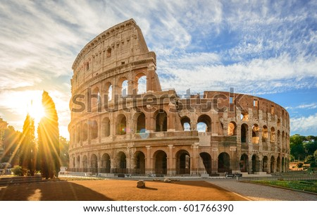 Colosseum at sunrise, Rome, Italy, Europe. Rome ancient arena of gladiator fights. Rome Colosseum is the best known landmark of Rome and Italy