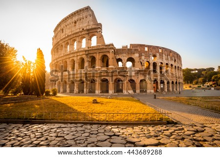 Colosseum at sunrise, Rome, Italy. Rome landmark and antique architecture. Rome Colosseum is one of the best known monuments of Rome and Italy