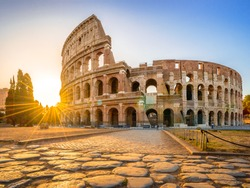 Colosseum at sunrise, Rome. Rome architecture and landmark. Rome Colosseum is one of the best known monuments of Rome and Italy