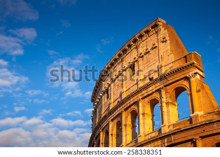 Colosseum at sunset, Rome, Italy, Europe. Rome ancient arena of gladiator fights. Rome Colosseum is the best known landmark of Rome and Italy