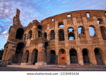 Colosseum gladiator arena famous ancient history roman empire architecture exterior theater historical travel tourism landmark ruin amphitheater monument colosseo stadium building at sunset Italy Rome #1218481636