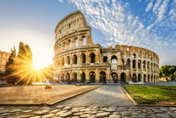 Colosseum in Rome and morning sun, Italy, Europe.