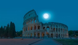 Colosseum in Rome at night with full moon . Colosseum is the most landmark in Rome