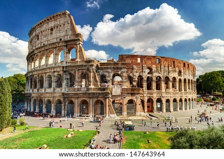 Colosseum in Rome, Italy. Ancient Roman Colosseum is one of main tourist attractions in Europe. People visit the famous Colosseum in Roma city center. Scenic nice view of Colosseum ruins in summer. Stockfoto ©