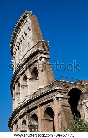 Colosseum in Rome with blue sky, landmark of the city