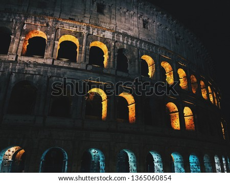 Colosseum in the night, lightening from inside