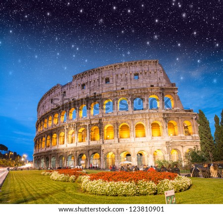 Colosseum - Rome. Night view with surrounding grass and park.