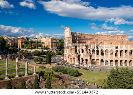 Colosseum with clear blue sky and clouds, Rome, Italy. Rome architecture and landmark. Rome Colosseum is one of the best known monuments of Rome and Italy
