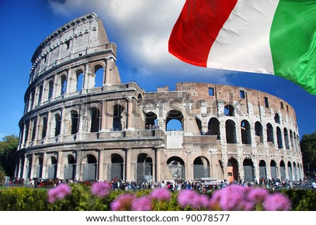 Colosseum with flag of Italy in Rome