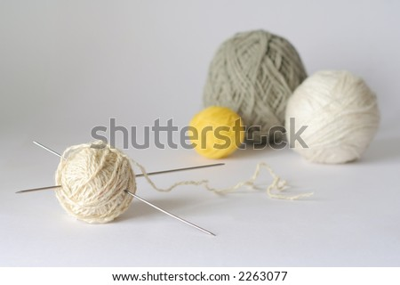 colour clews and knitting needle