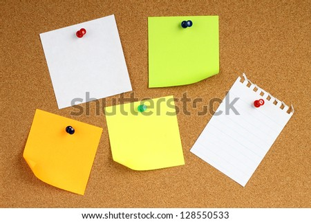 Colour note papers on wooden background