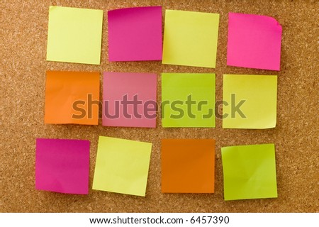 Colour notes on corkboard - stock photo