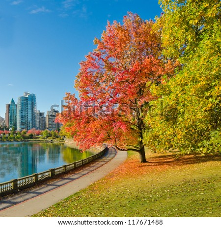 Colour of the autumn. Gorgeous sea walk in the park. Stanley Park in Vancouver. Canada.