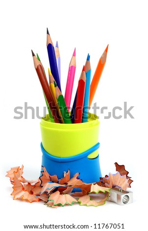 Colour pencils in pencil case and pencil sharpener with shaving - stock photo