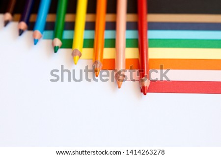 Colour pencils. Multicolored pencils. Back to school. School. Stationery. Place for text. Pencil. View from above.  Mock up. Template.