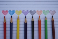 colour pencils with colour full heart image in paper