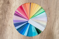 Colour samples decomposed in circle on wooden table