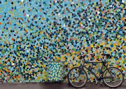 Colour your world and ride a bike. Blue bicycle in front of  colourful wall, streets of Düsseldorf, North Rhine-Westphalia, Germany,