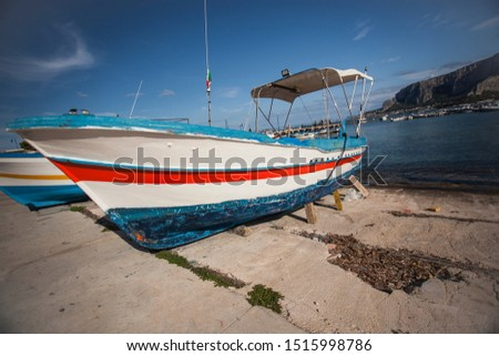 Coloured Boat stranded on the shore