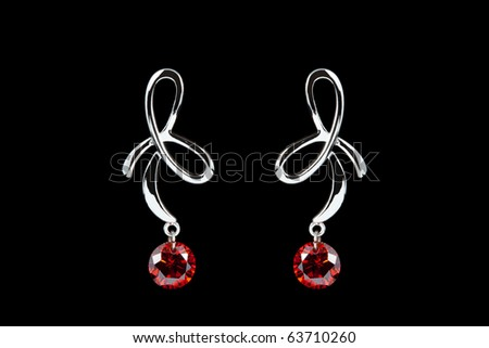 coloured earrings on black - stock photo