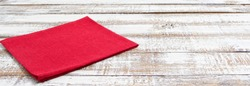 coloured napkins on empty wooden table - top view, copy space