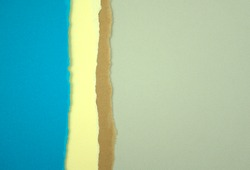 Coloured paper abstract texture background. Empty torn blue, neutral, pastel, earth tone, grey color papers combination. Free space for text, message, caption, or image. Top view, horizontal style.