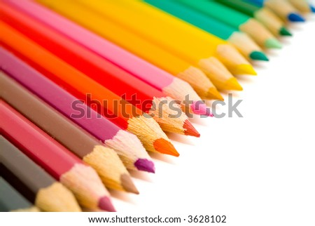 coloured pencils with shadow on white background - stock photo