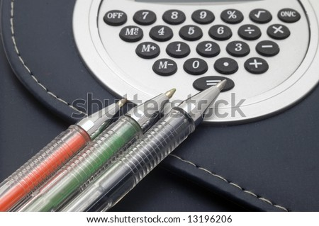 Coloured pens on notebook background.